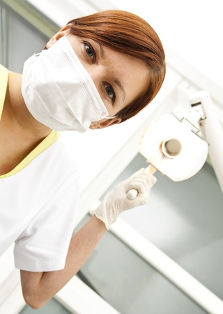 Portrait of a dentist in exam room  photo