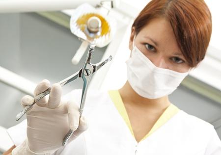dental hygienist: Portrait of a dentist in exam room