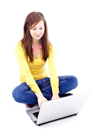 teen girl brown hair: Young, beautiful girl sitting in front of laptop