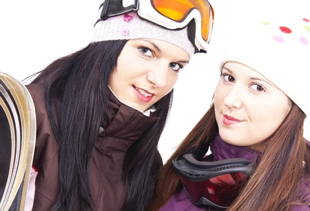 Two beautiful friends getting ready for skiing photo