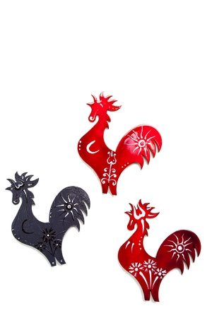 Colored roosters on white background photo