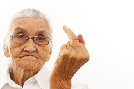 old woman with a hat showing her F finger