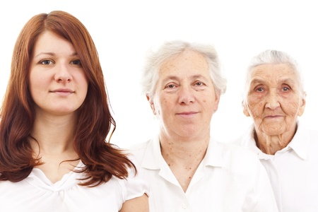 different concept: three women from three generations standing in white generations in white standing in f Stock Photo