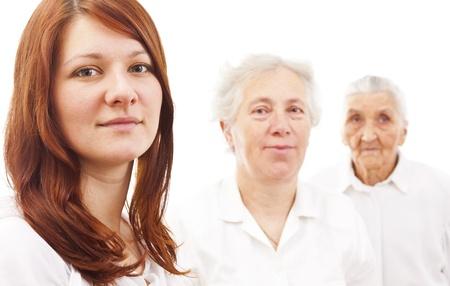 three women from three generations standing in white generations in white standing in f Stock Photo