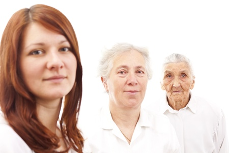 three women from three generations standing in white generations in white standing in f Stock Photo
