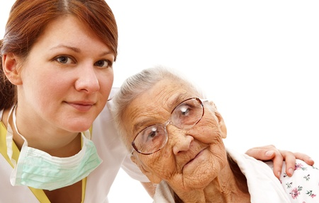 Young female doctor  caring about a very old female patient photo