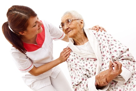 old carer: Young female doctor  caring about a very old female patient Stock Photo