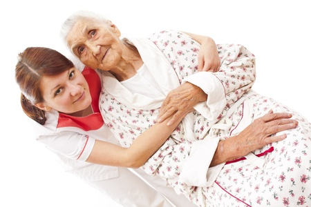 carer: Young female doctor  caring about a very old female patient Stock Photo
