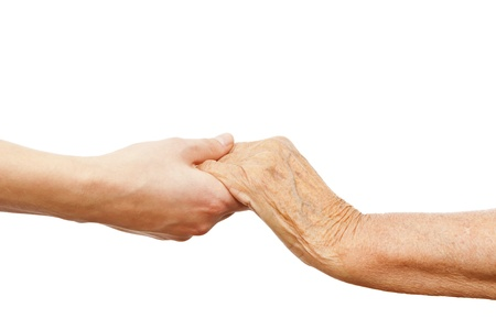 a young  hand holding an older one