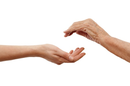 old hand: a young  hand holding an older one