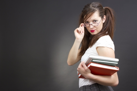 Estudiante femenino con sus libros photo