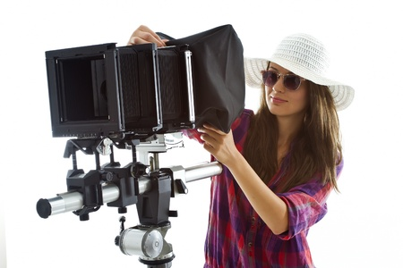 proffessional: young girl with a proffessional analog photographic equipment