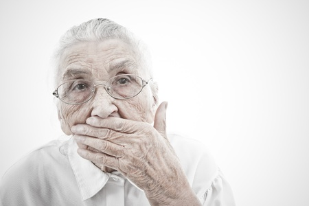 decrepitude: portrait of a very old woman  who is masking her mouth with her hand