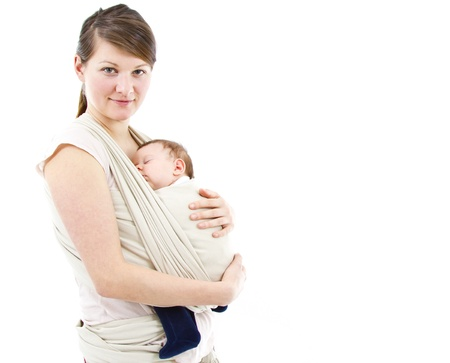 sling: young mother carrying a  newborn sleepimg  baby