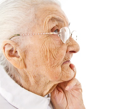 wise woman:  portrait of an old lady contemplating on an isolated background