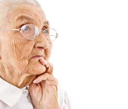 one of a kind:  portrait of an old lady contemplating on an isolated background