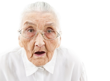 woman mouth open: portrait of a surprised old woman who is staring with open mouth Stock Photo
