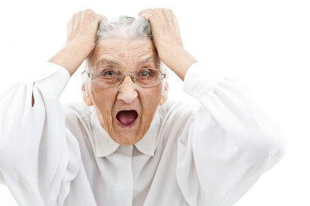 pensioner: very old woman tearing her hair