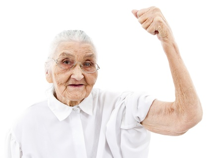 decrepitude: very old woman showing her muscles on her arms