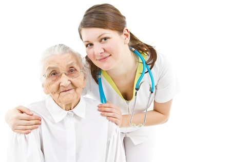 old carer: young female doctor is caring for her old  patient Stock Photo