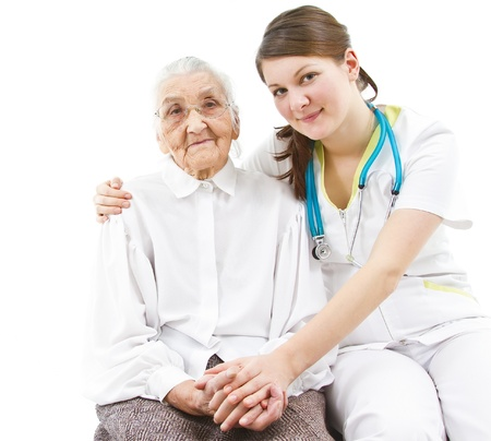 caring for: young female doctor is caring for her old  patient Stock Photo