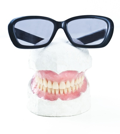 dental prosthesis ona  gypsum model with sunglasses photo