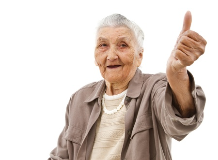 old lady showing thumbs up in front of an isolated background photo