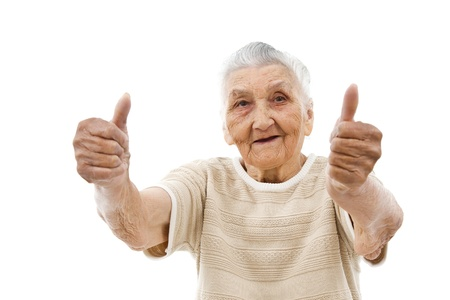 old lady showing thumbs up in front of an isolated background