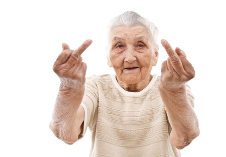 very old woman showhing her f-finger on both of her hands photo