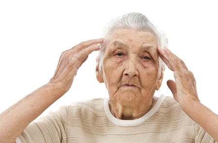 depressed old lady with her hands on her head