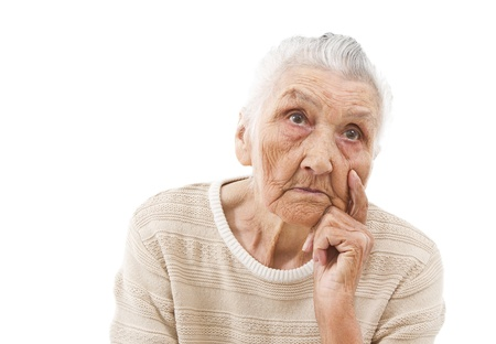 unhappy old lady contemplating on an isolated background photo
