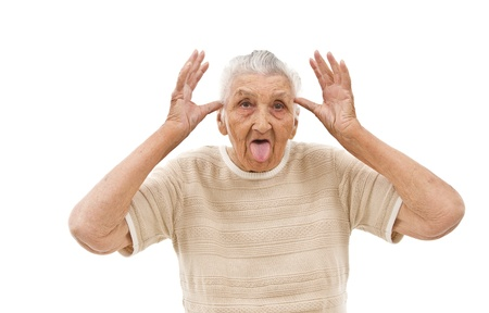 behaving: very old woman behaving like a  child on an isolated background Stock Photo