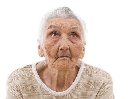 very old lady contemplating on an isolated background photo