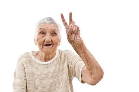 grandma showing peace sign on an isolated background photo