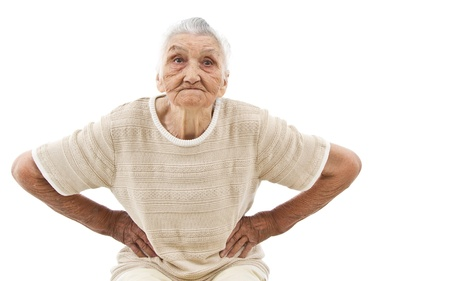 angry old woman with hands on her hips, isolated on white photo