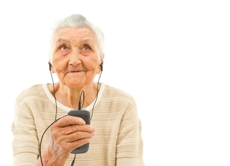 old people smiling: very old lady isolated on white  listening to music on the phone