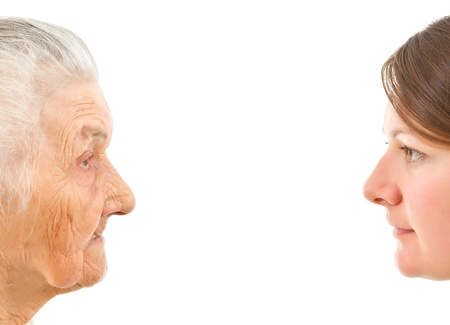 old and young faces up against each other on an isolted background