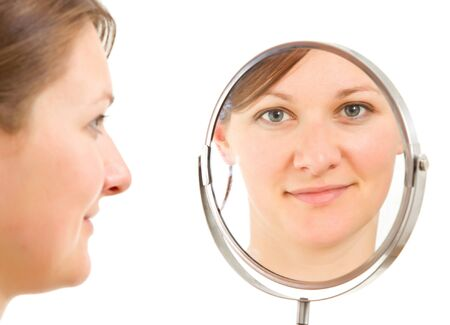 mirror face: young womans  isolated portrait reflecting froma  bathroom mirror Stock Photo
