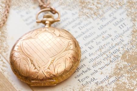 pocket book: closed vintage  gold pocket watch on a book