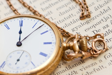 pocket book: vintage pocket watch on an  book Stock Photo