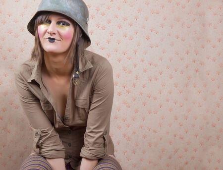 special agent: young woman  wearing an  army helmet and a funny make up  Stock Photo