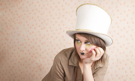 glove puppet: young woman wearing a creative visage and a white top hat Stock Photo