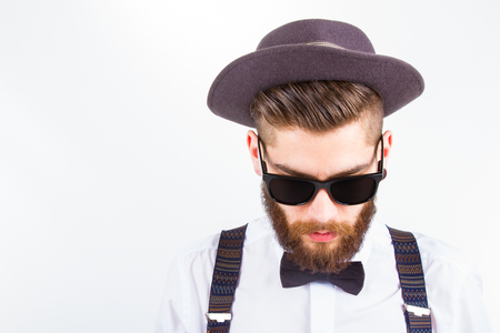 young hipster man wearing  hat and bow-tie Stock Photo
