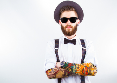 sleeve: young hipster man wearing  hat, suspenders,  bow-tie and a funny tattoo-sleeve