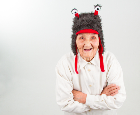 funny face: very old lady in funny fur hat with two tentacles