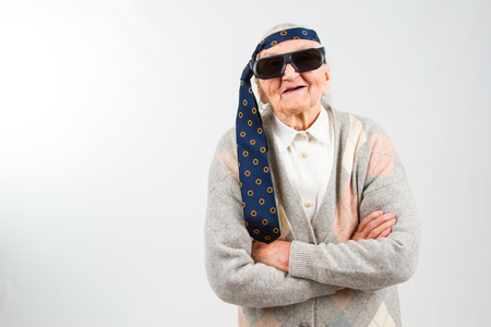 Funny grandma's studio portarit with a tie on her forehead