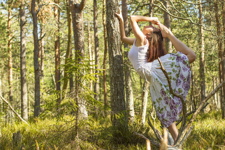 ballerina fairy: beautiful young ballet dancer girl in the forest in springtime Stock Photo