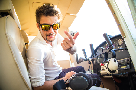 attractive pilot sitting in the plane photo