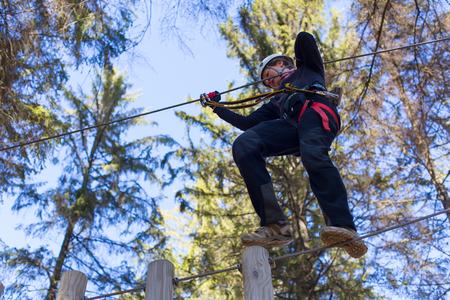 young woman having fun in an outdoor adventure park photo