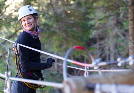 woung woman  having fun in an adventure park in the forest photo